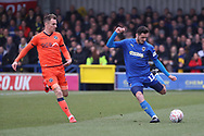 AFC Wimbledon defender Tyler Garratt (12) passing the ball during the The FA Cup 5th round match between AFC Wimbledon and Millwall at the Cherry Red Records Stadium, Kingston, England on 16 February 2019.