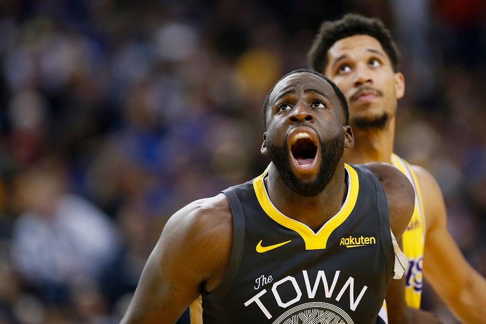 Golden State Warriors forward Draymond Green (23) fights for position during a free throw in the second half of an NBA game against the Los Angeles Lakers at Oracle Arena on Saturday, Feb. 2, 2019, in Oakland, Calif. The Warriors won 115-101.