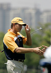 Apr 19, 2007 - Shanghai, CHINA - RETIEF GOOSEN of South Africa shakes hands with the audience after a shot on the 18th hole during the first round of the 2007 BMW Asian Open at the Tomson Shanghai Pudong Golf Club in Shanghai. (Credit Image: © Xi Shui/Color China Photos/ZUMA Press)