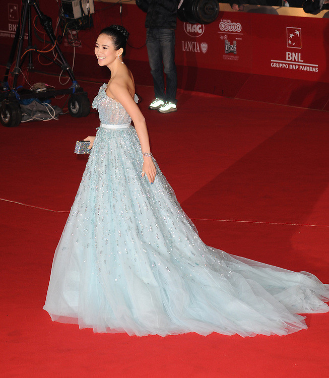 """Zhang Ziyi attends the premiere of """"Love for Life"""" during the 6th International Rome Film Festival. Zhang Ziyi wears dress by Dior and jewellery by Swarovski. November 2, 2011, Rome, Italy."""