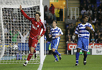 Photo: Lee Earle.<br /> Reading v Liverpool. Carling Cup. 25/09/2007. Fernando Torres (L) celebrates after scoring his hat-trick. Reading's Ulises de la Cruz (R) looks dejected.