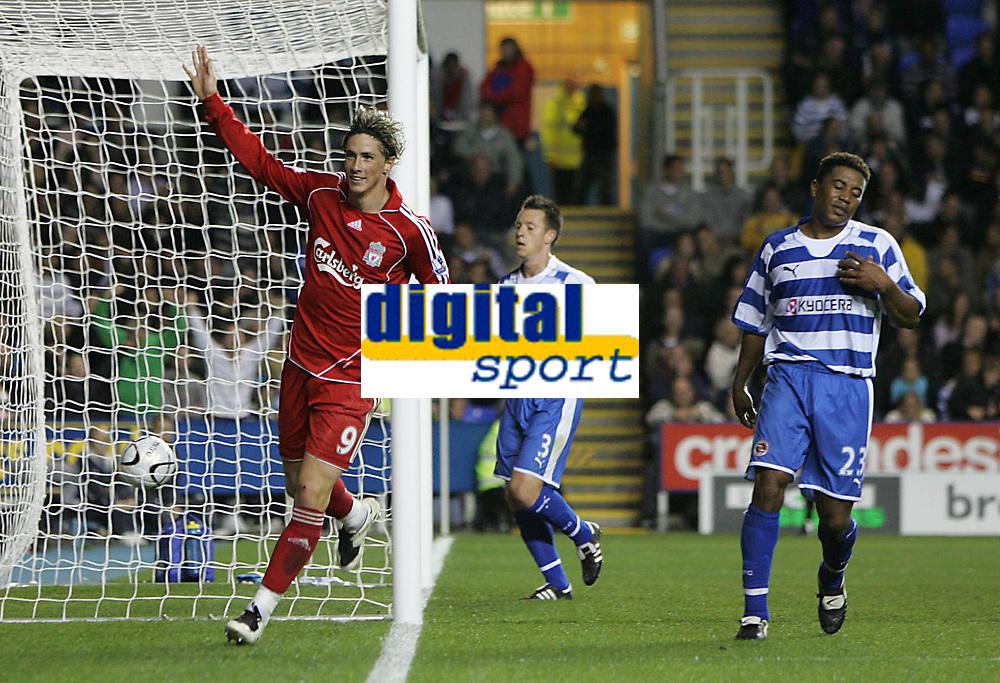Photo: Lee Earle.<br /> Reading v Liverpool. Carling Cup. 25/09/2007. Fernando Torres (L) celebrates after scoring his hat-trick. Reading's Ulises de la Cruz (R) looks dejected.