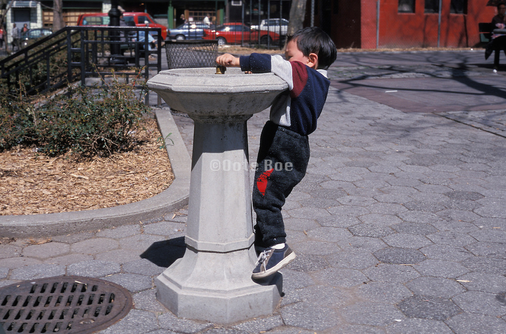 boy struggling with water fountain