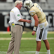 UCF Knights head coach George O'Leary talks to UCF Knights quarterback Blake Bortles (5) during an NCAA football game between the South Carolina Gamecocks and the Central Florida Knights at Bright House Networks Stadium on Saturday, September 28, 2013 in Orlando, Florida. (AP Photo/Alex Menendez)