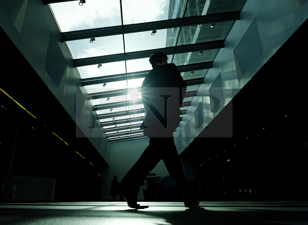 (c) Licensed to London News Pictures. <br /> 03/10/2017<br /> Manchester, UK<br /> <br /> A delegate walks through the foyer of the conference centre during the Conservative Party Conference held at the Manchester Central Convention Complex.<br /> <br /> Photo Credit: Ian Forsyth/LNP