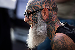 A man show off his tattoos during the International tattoo convention at Tobacco Dock in east London.