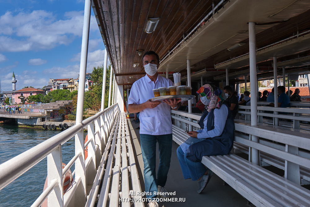 Man with tea and coffee tray on a ferry in Istanbul between Karakoy, Eminonu and Uskudar districts