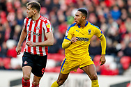 Sunderland forward Charlie Wyke (9) is watched by Wimbledon defender Terell Thomas (6)  during the EFL Sky Bet League 1 match between Sunderland and AFC Wimbledon at the Stadium Of Light, Sunderland, England on 2 February 2019.