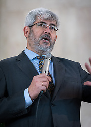 1 December 2019, Madrid, Spain: Rev. Alfredo Abad welcomes shares words of welcome as representatives of various faiths gather in the Iglesia de Jesús (Church of Christ) of the Iglesia Evangélica Española (Evangelical Church of Spain) for an interfaith dialogue and prayer service on the eve of the United Nations climate conference (COP25) in Madrid, Spain.