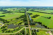 Nederland, Gelderland, Geldermalsen, 23-08-2016; Diefdijk met wiel, overblijfsel van een dijkdoorbraak. De dijk maakt onderdeel uit van Nieuwe Hollandse Waterlinie en omdat de dijk doorsneden wordt door de spoorlijn Leerdam-Geldermalsen is er een fort gebouwd (naam Werk op de spoorweg bij de Diefdijk). De Diefdijk is ook een binnendijk en oorspronkelijk aangelegd om de Alblasserwaard en de Vijfherenlanden tegen wateroverlast uit de Betuwe te beschermen.<br /> Diefdijk with 'wheel', the remnants of a dike breach. The inner dike was originally built to protect the polders Alblasserwaard and Vijfherenlanden against flooding from the Betuwe. In addition, the dike is part of the New Dutch Waterline, hence the fortress which protects the 'breach' made by the railway.<br /> <br /> luchtfoto (toeslag op standard tarieven); aerial photo (additional fee required); copyright foto/photo Siebe Swart