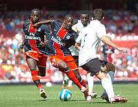 Photo: Tony Oudot.<br /> Paris Saint-Germain v Valencia. The Emirates Cup. 29/07/2007.<br /> Younousse Sankhare of Paris St Germain goes through the Valencia defence