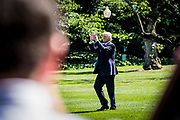 President Donald Trump applauds onlookers as he makes his way across the South Lawn to depart on Marine One at the White House in Washington, District of Columbia, U.S., on Friday, June 9, 2017. Trump is heading to New Jersey for the weekend.