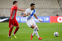 ATHENS, GREECE - OCTOBER 11: Vangelis Pavlidisof Greece and Vadim Raţăof Moldova during the UEFA Nations League group stage match between Greece and Moldova at OACA Spyros Louis on October 11, 2020 in Athens, Greece. (Photo by MB Media)