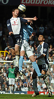 Photo: Ed Godden.<br />Tottenham Hotspur v Manchester City. The Barclays Premiership. 08/04/2006. Teemu Tainio (L) is met in the air by Man City's Albert Riera.