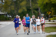 Group of joggers keeping fit on early morning jog, Anna Maria Island, Florida, United States of America