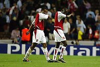 Photograph: Scott Heavey, Digitalsport<br /> Arsenal v Inter. Champions League. 17/09/2003.<br /> Ashley Cole (L) and Lauren walk off unhappy after the 0-3 drubbing.