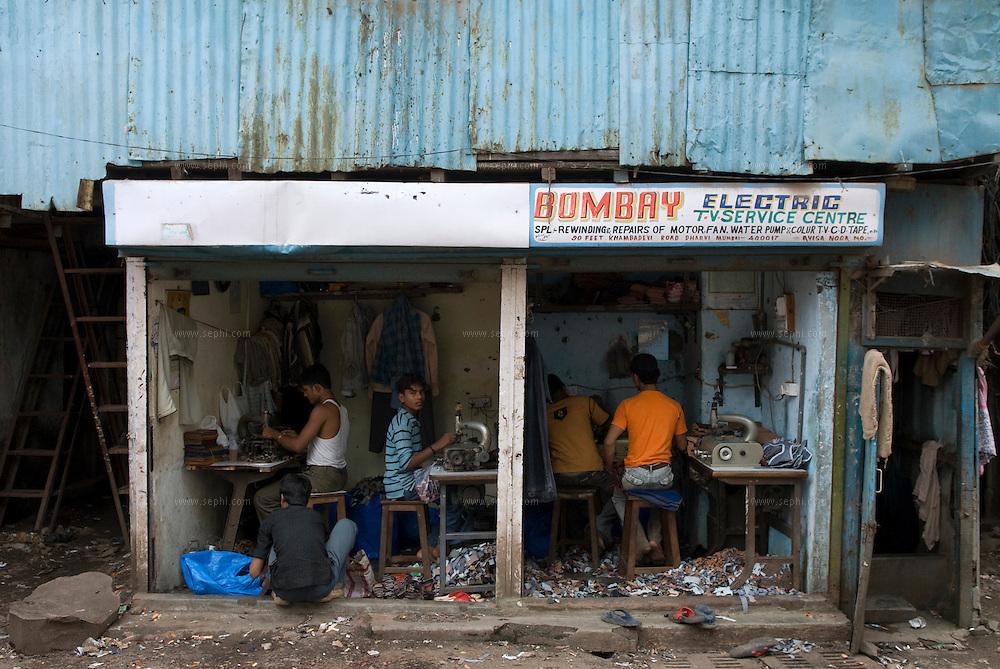 Tailors at work. Dharavi, Mumbai August 2007