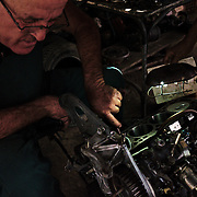 Working hard to keep the old American and Soviet cars running