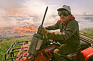 Burning of rice stubble is being phased out in California's central valley.  This rice farmer was setting his fields to burn with the use of a flame thrower and an ATV.