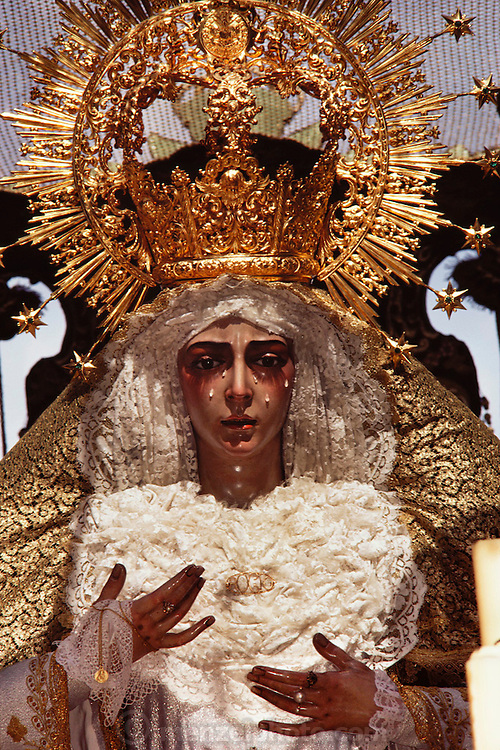 Sad Mary on Holy week in Seville, Spain. Street processions are organized in most Spanish towns each evening, from Palm Sunday to Easter Sunday. People carry statues of saints on floats or wooden platforms, and an atmosphere of mourning can seem quite oppressive to onlookers.