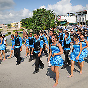 Young men and women in bright blue costumes participate in the Guatemaln Independence Day procession on 15 September 2011. As part of the celebrations groups of school students parade in a procession through the streets of Flores, starting in the Parque Central, walking through the town, and crossing the causeway into Santa Elena.