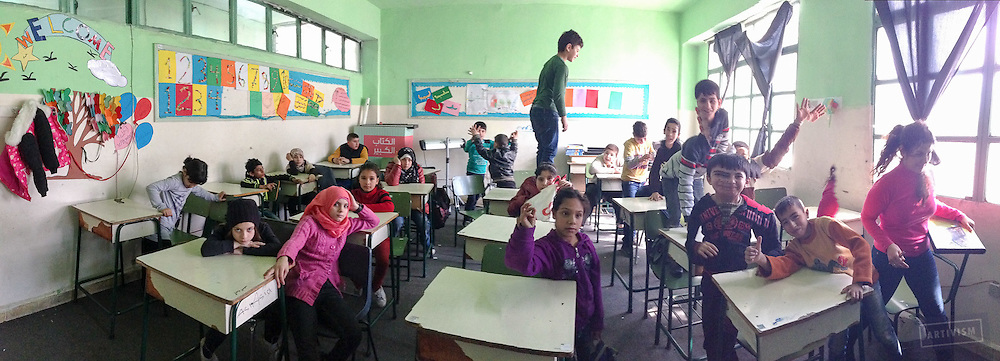 Syrian students during an art class. Some of these children are recent arrivals from the war zone.