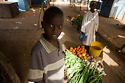 Ishmael Ishag, 12 pushes his wheelbarrow full of fresh vegetable produce through the 4 sq km Abu Shouk refugee camp which is (disputedly) home to 38,000 displaced persons and families on the outskirts of the front-line town of Al Fasher (also spelled, Al-Fashir) in north Darfur.