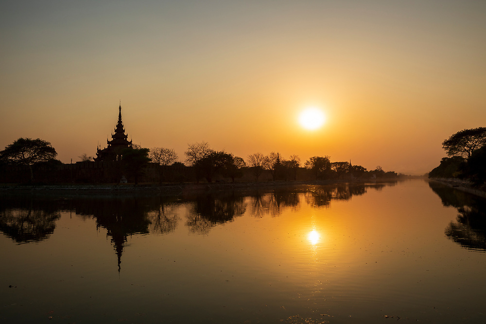 Sunset at Mandalay fort. Looking like a massive soundwave on the skyline. Mandalay Palace was the primary royal residence of King Mindon and King Thibaw, the last two kings of the country. The complex ceased to be a royal residence and seat of government on 28 November 1885 when, during the Third Anglo-Burmese War, troops of the Burma Field Force entered the palace and captured the royal family. The British turned the palace compound into Fort Dufferin, named after the then viceroy of India. Throughout the British colonial era, the palace was seen by the Burmese as the primary symbol sovereignty and identity. Much of the palace compound was destroyed during World War II by allied bombing; only the royal mint and the watch tower survived. A replica of the palace was rebuilt in the 1990s with some modern materials.