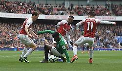 Brighton & Hove Albion's Yves Bissouma is surrounded by Arsenal's Stephan Lichtsteiner, Lucas Torreira and Stephan Lichtsteiner