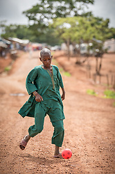 3 June 2019, Djohong, Cameroon: A young man kicks a ball in the Borgop refugee camp. The Borgop refugee camp is located in the municipality of Djohong, in the Mbere subdivision of the Adamaoua regional state in Cameroon. Supported by the Lutheran World Federation since 2015, the camp currently holds 12,300 refugees from the Central African Republic.