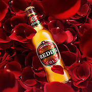 Bottle lying on bed of rose petals Ray Massey is an established, award winning, UK professional  photographer, shooting creative advertising and editorial images from his stunning studio in a converted church in Camden Town, London NW1. Ray Massey specialises in drinks and liquids, still life and hands, product, gymnastics, special effects (sfx) and location photography. He is particularly known for dynamic high speed action shots of pours, bubbles, splashes and explosions in beers, champagnes, sodas, cocktails and beverages of all descriptions, as well as perfumes, paint, ink, water – even ice! Ray Massey works throughout the world with advertising agencies, designers, design groups, PR companies and directly with clients. He regularly manages the entire creative process, including post-production composition, manipulation and retouching, working with his team of retouchers to produce final images ready for publication.