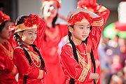 """14 FEBRUARY 2010 - PHOENIX, AZ: Girls perform a traditional Chinese dance during Chinese New Year celebrations in Phoenix, AZ. This marks the Chinese """"Year of the Tiger."""" The Chinese New Year Celebration at the COFCO Chinese Cultural Center in Phoenix attracted thousands of people. The celebration featured traditional Chinese entertainment and food.  PHOTO BY JACK KURTZ"""