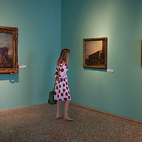 A journalist stands in front of two paintings during the Press Preview at Museo Correr of the Guardi Exhibition From September 29th 2012 to January 6th 2013.In the third centenary of the birth of Francesco Guardi, the last great landscape artist of the 18th century, the monographic exhibition promoted by the Fondazione dei Musei Civici di Venezia aims to highlight his complex artistic production, from the lesser-known figure paintings of his youth to the 'interior scenes', concluding with the splendid views of Venice and his fabulous capriccios, painted in his maturity and old age.