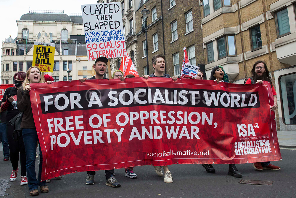 Supporters of Socialist Alternative join thousands of people attending a United Against The Tories national demonstration organised by the Peoples Assembly Against Austerity in protest against the policies of Prime Minister Boris Johnsons Conservative government on 26th June 2021 in London, United Kingdom. The demonstration contained blocs from organisations and groups including Palestine Solidarity Campaign, Stand Up To Racism, Stop The War Coalition, Extinction Rebellion, Kill The Bill and Black Lives Matter as well as from trade unions Unite and the CWU.