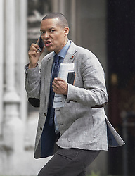 © Licensed to London News Pictures. 29/06/2016. London, UK. Newly selected Shadow Secretary of State for Defence CLIVE LEWIS MP makes a phone call in Parliament on June 29, 2016. Labour MPs yesterday passed a no-confidence motion in Jeremy Corbyn with a vote of 172-40 against the current Labour Party leader. Photo credit: Peter Macdiarmid/LNP