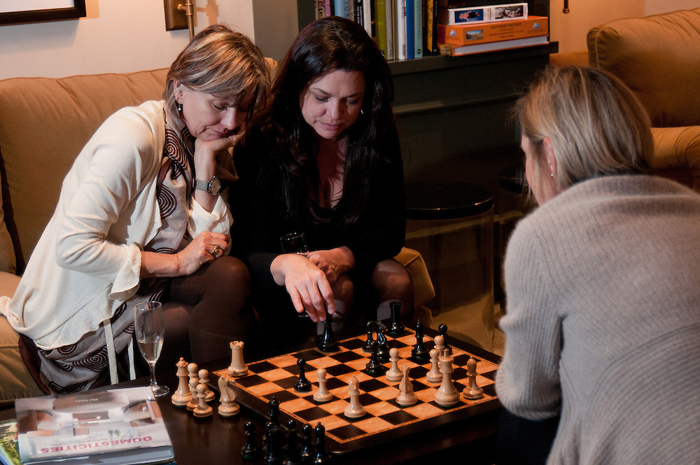The Four Seasons Residences Austin hosted a party Friday night for current, future and prospective residents. Susan Marone (L) Caprice Pierucci (C) and Anne Ducote enjoy a game of chess in the library.