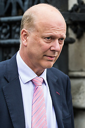 London, UK. 18 June, 2019. Chris Grayling MP, Secretary of State for Transport, leaves Parliament following the second round of voting for the leadership of the Conservative Party.
