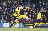 Oxford United's Rob Dickie (4) under pressure from Burton Albion forward Lucas Akins (10) during the EFL Sky Bet League 1 match between Burton Albion and Oxford United at the Pirelli Stadium, Burton upon Trent, England on 2 February 2019.