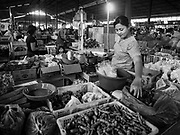 07 AUGUST 2017 - KECAMATAN, BALI, INDONESIA: A chili vender in the market in Kecamatan, in eastern Bali. Bali's local markets are open on an every three day rotating schedule because venders travel from town to town. Before modern refrigeration and convenience stores became common place on Bali, markets were thriving community gatherings. Fewer people shop at markets now as more and more consumers go to convenience stores and more families have refrigerators.     PHOTO BY JACK KURTZ