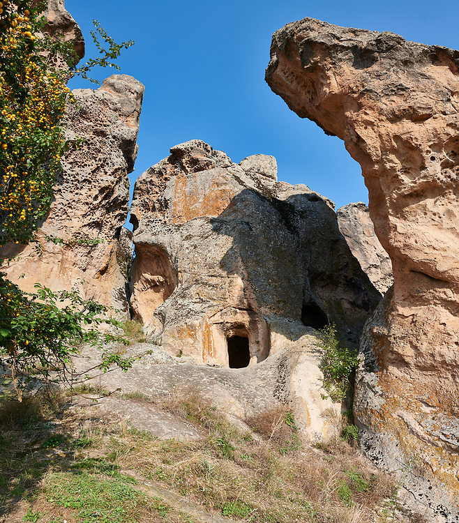 Phrygian tombs cut into rock formations  protecting the citadel of Midas . From the 8th century BC . Midas City, Yazilikaya, Eskisehir, Turkey.<br /> <br /> <br /> The earliest Phrygian settlement here began in the last quarter of the 8th century BC. Even after the Phrygian kingdom collapsed politically, the city was not abandoned and the Phrygian rock structures and tombs were conserved, with some additions and changes made.in the Persian, Hellenistic, Roman and Byzantine periods. .<br /> <br /> If you prefer to buy from our ALAMY PHOTO LIBRARY  Collection visit : https://www.alamy.com/portfolio/paul-williams-funkystock/ancient-midas-turkey.html<br /> <br /> Visit our CLASSICAL WORLD HISTORIC SITES PHOTO COLLECTIONS for more photos to download or buy as wall art prints https://funkystock.photoshelter.com/gallery-collection/Classical-Era-Historic-Sites-Archaeological-Sites-Pictures-Images/C0000g4bSGiDL9rw