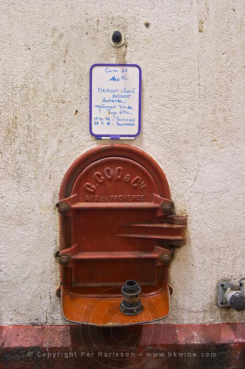 Merlot 2006. Domaine Le Nouveau Monde. Terrasses de Beziers. Languedoc. Concrete fermentation and storage vats. Sign on tank. France. Europe.