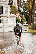 A bicycle rides through floodwater along the Battery in the historic district as Hurricane Joaquin brings heavy rain, flooding and strong winds as it passes offshore October 4, 2015 in Charleston, South Carolina.
