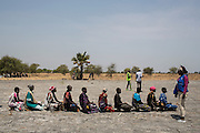 Mcc0075406 . Daily Telegraph<br /> <br /> DT Foreign<br /> <br /> Women wait to get their bags of Sorghum grain from the food distribution centre .<br /> <br /> Women and children walked for hours today to UN food air drop in Padeah , in a famine hit area of war torn Unity State . <br /> <br /> <br /> Padeah 1 March 2017