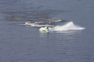 Highland, N.Y. - A man rides his personal watercraft on the Hudson River near the Mid-Hudson Bridge between Highland and Poughkeepsie on July 8, 2006. The photograph was taken from the walkway of the Mid-Hudson Bridge. ©Tom Bushey