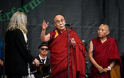 ©London News Pictures. Glastonbury Festival 2015<br /> <br /> Dalai Lama joins Patti Smith on Pyramid stage on Sunday during Glastonbury Festival 2015, Worthy Farm, Pilton.<br /> <br /> Date: 28/06/2015<br /> Photographer: Artur Lesniak /LNP