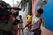 Carla Siccos who runs local newswire CDD Acontece, being interviewed by Canadian TV. Cidade de Deus / City of God favela in Rio de Janeiro, made infamous by the film of the same name, is a bustling community of close to 100,000 inhabitants, with numerous cultural and social projects.
