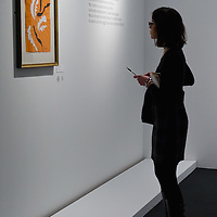 "BRESCIA, ITALY - FEBRUARY 11:  A visitor admires ""Danzatrice Acrobatica"" by Matisse at the  Santa Giulia Museum on February 11, 2011 in Brescia, Italy. The exhibition ""Matisse La Seduzione di Michelangelo"" shows  180 works of the French artist and will stay open until June 12th 2011"
