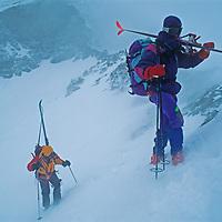 Jay Jensen and Allan Pietrasanta cross a stormy pass on the classic Haute Route ski tour through the Alps between Chamonix, France and Zermatt, Switzerland.