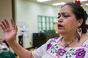 27 JUNE 2012 - GLENDALE, AZ:  SOCORRO MARTINEZ, 64 years old, sings during rehearsal for the Senior Fiesta Dancers at the Glendale Adult Center, in Glendale, AZ, a suburb of Phoenix. Dancing as a part of workout regimen is not unusual, but the Senior Fiesta Dancers use Mexican style folklorico dances for their workouts. The Senior Fiesta Dancers have been performing together for 15 years. They get together every week for rehearsals and perform at nursing homes and retirement centers in the Phoenix area once a month or so. Their energetic Mexican folklorico dances keep them limber and provide a cardio workout.   PHOTO BY JACK KURTZ