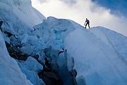 Jim Prager ascends the Eldorado Glacier below Eldorado Peak, past a large bergschrund, North Cascades National Park, Washington.